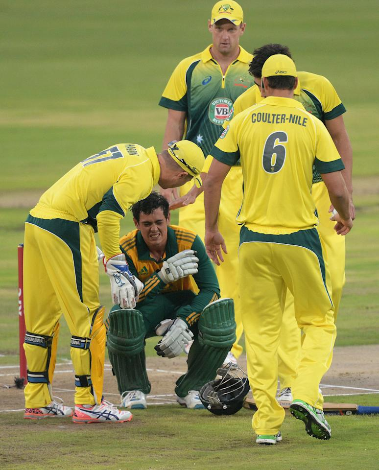 CENTURION, SOUTH AFRICA - MARCH 14:Quinton de Kock of SA hit by a bouncer  during the 3rd KFC T20 International match between South Africa and Australia at SuperSport Park on March 14, 2014 in Centurion, South Africa. (Photo by Duif du Toit/Gallo Images/Getty Images)