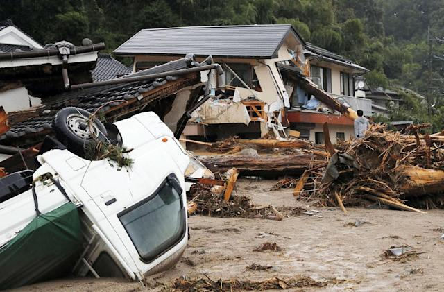 <p>A man stands amid debris caused by a swollen river in Asakura, Fukuoka prefecture, southwestern Japan Thursday, July 6, 2017. Heavy rain following a recent typhoon flooded many houses in southwestern Japan, forcing thousands of people to flee, authorities said. (Photo: Takuto Kaneko/Kyodo News via AP) </p>