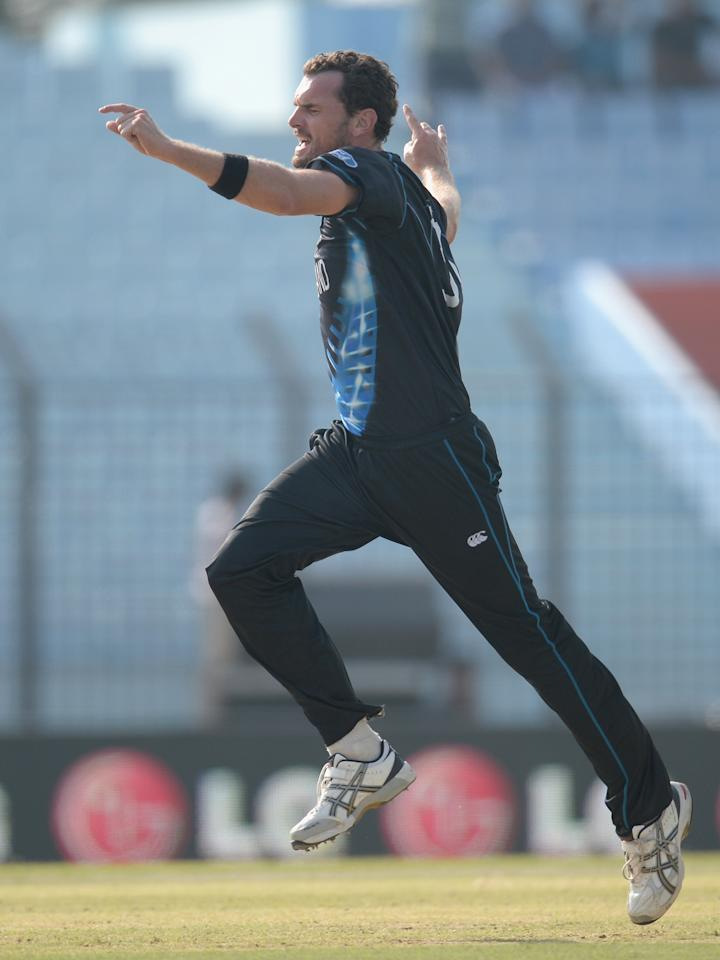 CHITTAGONG, BANGLADESH - MARCH 24:  Kyle Mills of New Zealand celebrates dismissing Quinton de Kock of South Africa during the ICC World Twenty20 Bangladesh 2014 Group 1 match between New Zealand and South Africa at Zahur Ahmed Chowdhury Stadium on March 24, 2014 in Chittagong, Bangladesh.  (Photo by Gareth Copley/Getty Images)