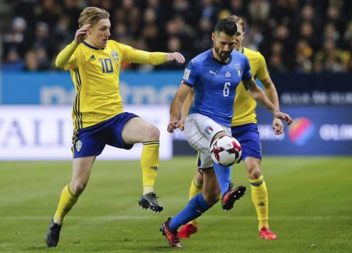 FILE - In this Friday, Nov. 10, 2017 filer, Sweden's Emil Forsberg, left, challenges Italy's Antonio Candreva during the World Cup qualifying play-off first leg soccer match between Sweden and Italy, at the Friends Arena in Stockholm. (AP Photo/Frank Augstein, File)