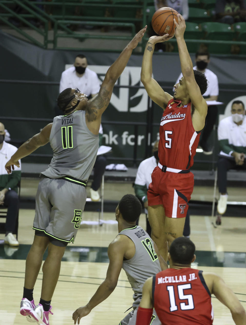 Texas Tech guard Micah Peavy (5) attempts a shot over Baylor guard Mark Vital (11) in the first half of an NCAA college basketball game Sunday, March 7, 2021, in Waco, Texas. (AP Photo/Jerry Larson)