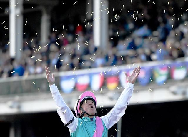 Frankie Dettori celebrates after riding Expert Eye to victory in the Breeders' Cup Mile on Saturday (AFP Photo/Bobby Ellis)