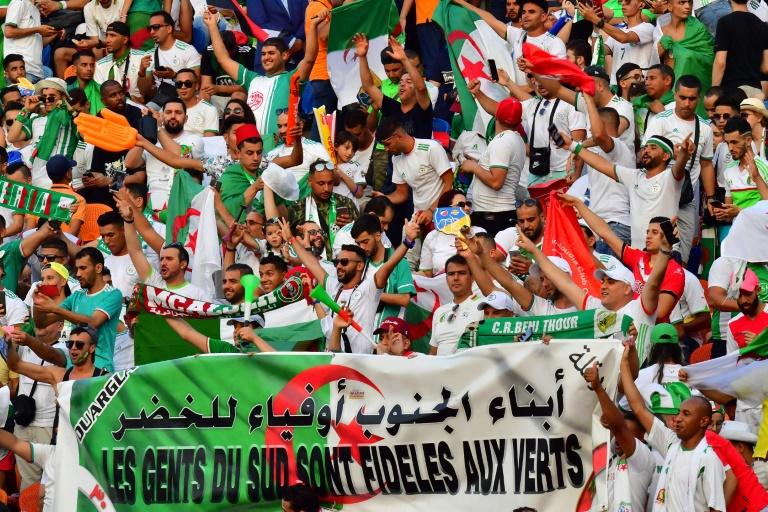Algeria supporters cheer ahead of the 2019 Africa Cup of Nations (CAN) final football match between Senegal and Algeria at the Cairo International Stadium on July 19, 2019 (AFP Photo/Giuseppe CACACE)