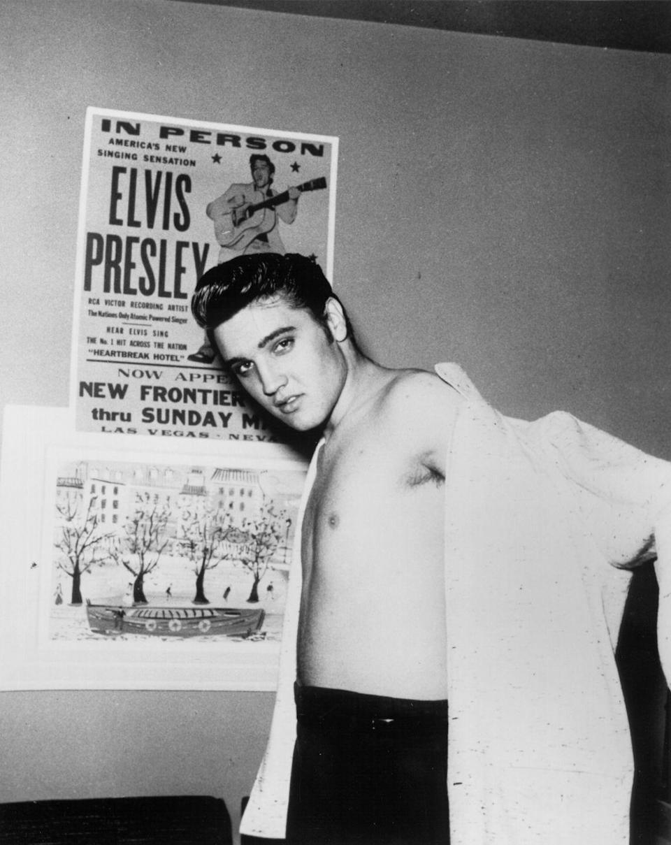 <p>Elvis Presley in front of a concert poster at the New Frontier Hotel. The resort hosted Presley's first Vegas appearance in 1956.</p>