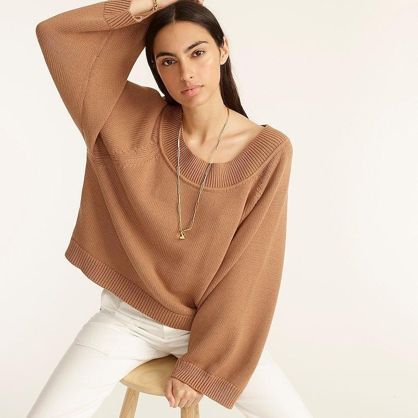 """<br><br><strong>J. Crew</strong> Relaxed-sleeve boatneck beach sweater, $, available at <a href=""""https://go.skimresources.com/?id=30283X879131&url=https%3A%2F%2Fwww.jcrew.com%2Fp%2Fwomens%2Fcategories%2Fclothing%2Fsweaters%2Fpullovers%2Frelaxed-sleeve-boatneck-beach-sweater%2FBA410%3Fdisplay%3Dsale%26fit%3DClassic%26isFromSale%3Dtrue%26color_name%3Dnavy%26colorProductCode%3DBA410"""" rel=""""nofollow noopener"""" target=""""_blank"""" data-ylk=""""slk:J. Crew"""" class=""""link rapid-noclick-resp"""">J. Crew</a>"""