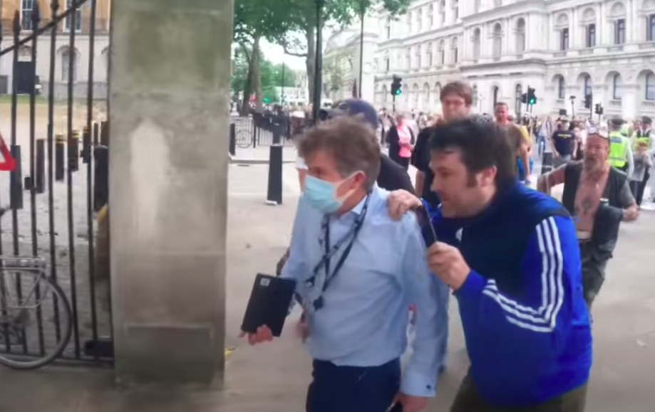One protester grabbed BBC journalist Nick Watt by the shoulder. (Resistance GB/YouTube)