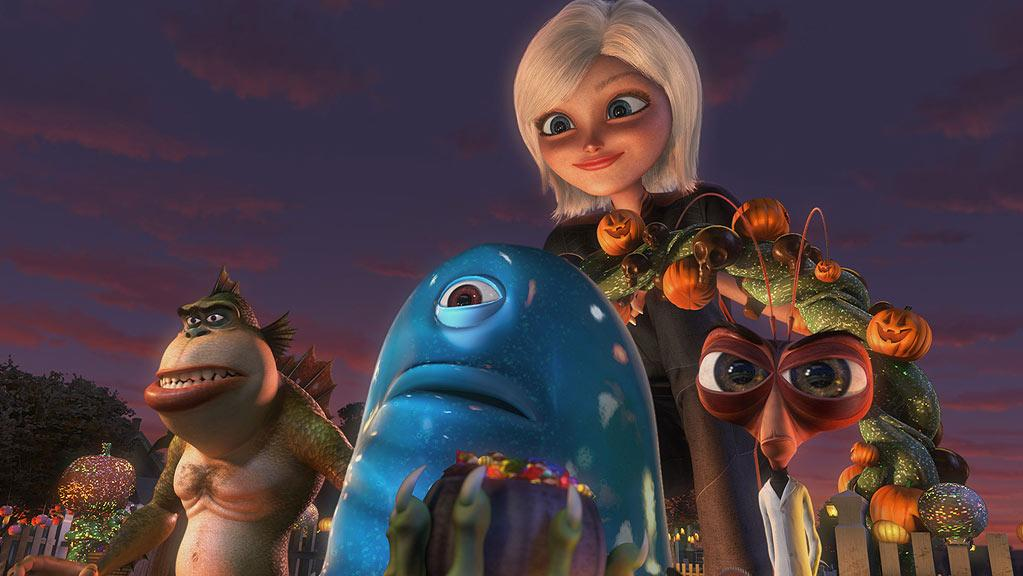 "The Missing Link (voiced by Will Arnett), B.O.B. (voiced by Seth Rogen), Susan/Ginormica (voiced by Reese Witherspoon), Dr. Cockroach Ph.D. (voiced by Hugh Laurie) in ""Monsters Vs. Aliens: Mutant Pumpkins From Outer Space."""