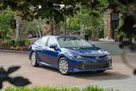 """<p>Expectations for the eighth generation of the Camry ran high when it made its debut at the 2017 Detroit auto show sporting attractive new sheetmetal. The new car transitioned to an all-new platform for the first time in many years, Toyota's TNGA component set. The renaissance was perfectly timed, as the Camry faced stiff competition from the also-new Honda Accord. Believe it or not, the longtime rivals had never been redesigned for the same model year before, and 2018 was the first instance in which the two sedans were <a href=""""https://www.caranddriver.com/features/a15875018/the-state-of-accord-and-camry-all-new-at-the-same-time-for-the-first-time-ever/"""" rel=""""nofollow noopener"""" target=""""_blank"""" data-ylk=""""slk:all new at the same time"""" class=""""link rapid-noclick-resp"""">all new at the same time</a>. Although we were highly satisfied with the new Camry's sharper driving dynamics and its stronger four-cylinder, V-6, and hybrid powertrains, it failed to unseat the Accord from <a href=""""https://www.caranddriver.com/features/g15084479/cream-of-the-crop-the-winningest-cars-in-10best-history/?slide=15"""" rel=""""nofollow noopener"""" target=""""_blank"""" data-ylk=""""slk:its crushing 10Best Cars winning streak"""" class=""""link rapid-noclick-resp"""">its crushing 10Best Cars winning streak</a>. </p>"""