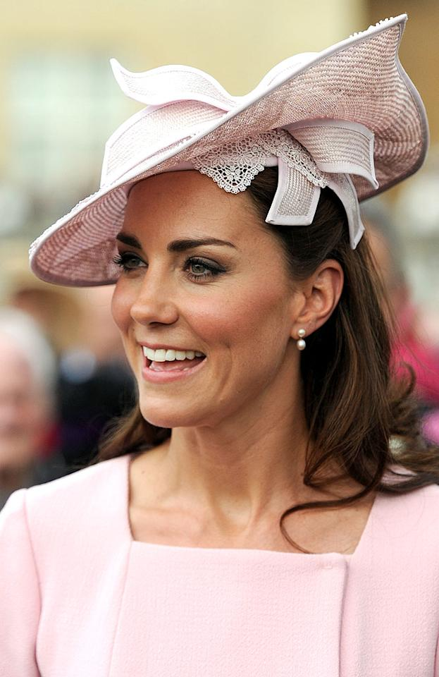 To be clear, we absolutely adore the Duchess of Cambridge and the vast majority of her outfits. However, even a future queen is capable of delivering a fashion faux pas. A perfect example of one of her rare style snafus would be the childish-yet-antiquated Jane Corbett chapeau she donned for a recent garden party. Hello? She's 30, not 90. (5/29/2012)
