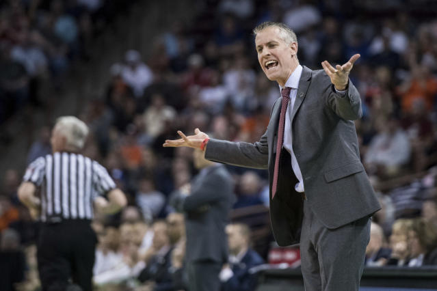 Gardner-Webb head coach Tim Craft communicates with an official during a first-round game against Virginia in the NCAA mens college basketball tournament Friday, March 22, 2019, in Columbia, S.C. Virginia defeated Gardner-Webb 71-56. (AP Photo/Sean Rayford)