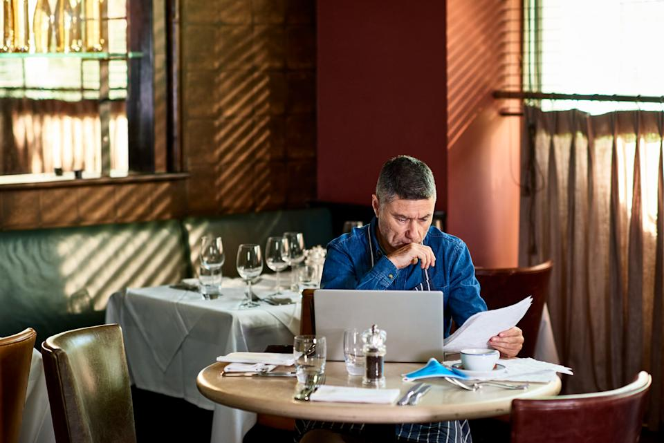 A restaurant owner working on his accounts