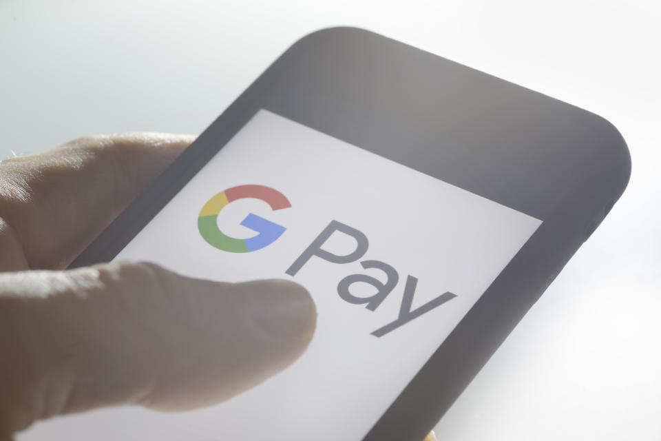 BERLIN, GERMANY - SEPTEMBER 28: The logo of the mobile payment system Google Pay is displayed on a smartphone on September 28, 2018 in Berlin, Germany. (Photo by Thomas Trutschel/Photothek via Getty Images)