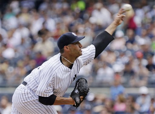 New York Yankees' Andy Pettitte delivers a pitch during the first inning of a baseball game against the Baltimore Orioles on Saturday, July 6, 2013, in New York. (AP Photo/Frank Franklin II)