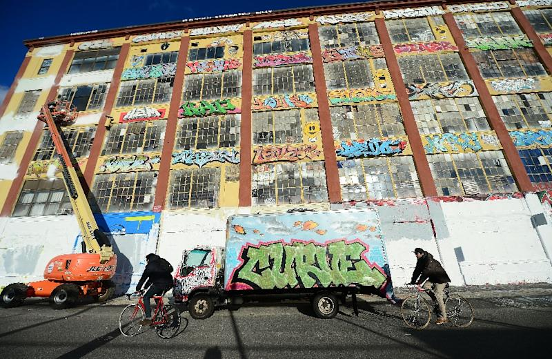 """New York's """"5Pointz,"""" an urban canvas of graffiti art, is seen here November 19, 2013 as work began to paint the building white ahead of its demolition"""