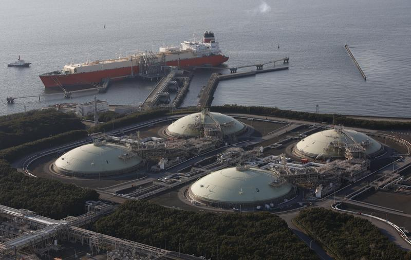 Liquefied natural gas storage tanks and a membrane-type tanker are seen at Tokyo Electric Power Co.'s Futtsu Thermal Power Station in Futtsu