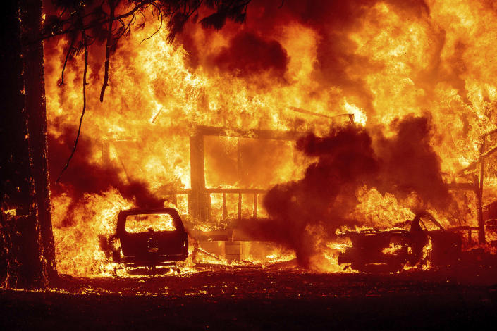 Flames consume a home