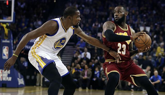 """Five years after their first Finals encounter, <a class=""""link rapid-noclick-resp"""" href=""""/nba/players/4244/"""" data-ylk=""""slk:Kevin Durant"""">Kevin Durant</a> and LeBron James square off again. Both wear different uniforms now. (AP)"""