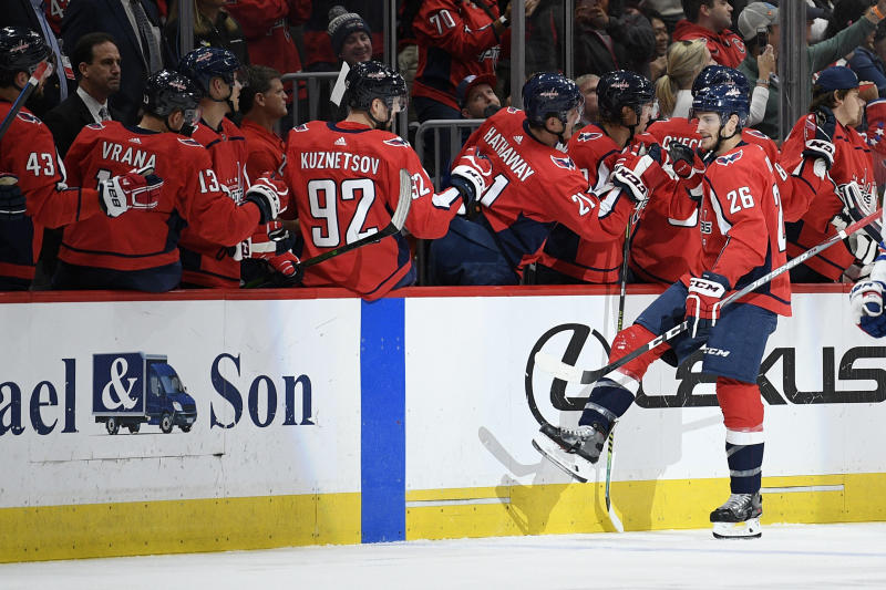 Washington Capitals center Nic Dowd (26) celebrates his goal during the second period of an NHL hockey game against the New York Rangers, Friday, Oct. 18, 2019, in Washington. (AP Photo/Nick Wass)