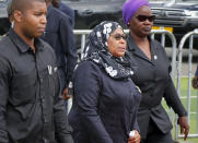 FILE - In this March 20, 2021 file photo, Tanzania's new President Samia Suluhu Hassan, center, arrives to pay her respects as the body of former president John Magufuli lies in state at Uhuru stadium in Dar es Salaam, Tanzania. Tanzania has received its first batch of 1 million Johnson & Johnson COVID-19 vaccines donated by the U.S. Tanzania had been among the few countries in Africa yet to receive vaccines or start vaccinating its population, mainly because its former leader had claimed prayer had defeated COVID-19 in the country. (AP Photo, File)