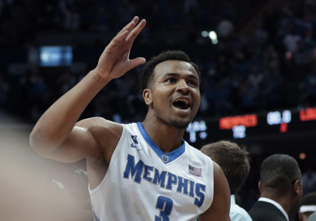Memphis' Chris Crawford celebrates his team's 72-66 victory over Louisville after an NCAA college basketball game in Memphis, Tenn., Saturday, March 1, 2014. (AP Photo/Danny Johnston)