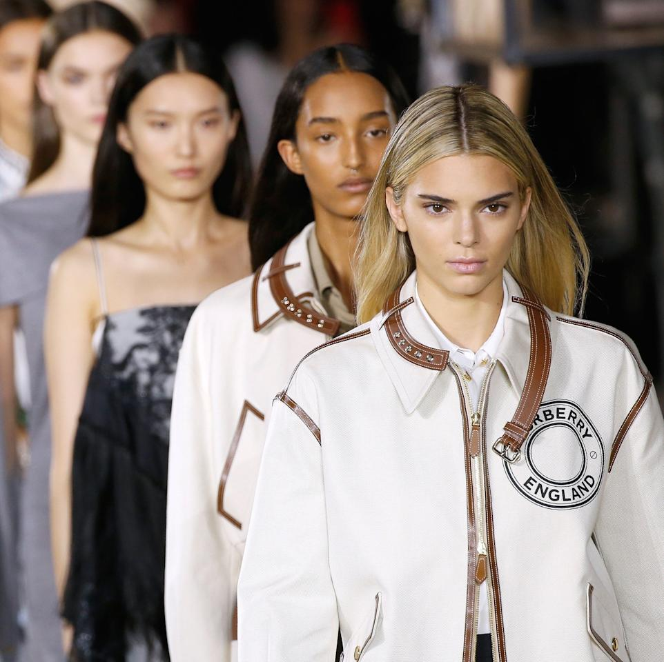 """The Burberry spring/summer 2020 collection is a nuanced take on Britishness under the lens of Italian designer Ricardo Tisci, who played with modern, sexy tailoring mixed in with streetwear influences as seen on the <a href=""""https://www.allure.com/story/kendall-jenner-blonde-burberry-london-fashion-week?mbid=synd_yahoo_rss"""" rel=""""nofollow"""">newly blonde Kendall Jenner</a>. Guido Palau kept the hair sleek, shiny and simple. He applied <a href=""""https://shop-links.co/1684447308287289373"""" rel=""""nofollow"""">Redken Extreme Play Safe</a> to damp hair to give it an extra shininess and heat protection before blow-drying it straight. To keep the hair modern and natural, Palau added a subtle bend on the ends with a two-inch curling iron and sealed it with <a href=""""https://shop-links.co/1684447408407466096"""" rel=""""nofollow"""">Redken's Triple Pure 32 Hairspray</a>."""