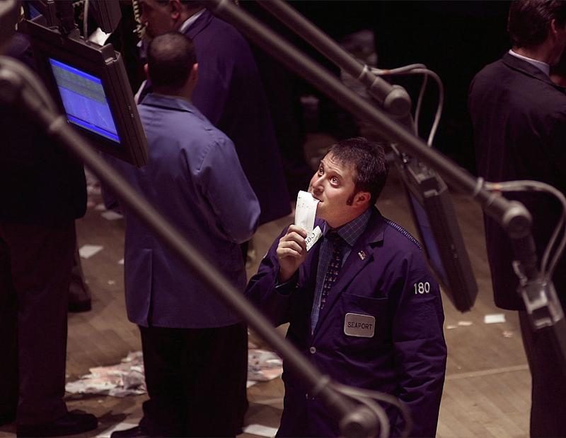 N367729 04: (MAGAZINES OUT) A trader looks at a monitor on the floor of the New York Stock Exchange in New York April 14, 2000. Stocks plummeted Friday in a broad sell-off as the Dow industrials fell over 600 points. (Photo by Chris Hondros/Newsmakers)