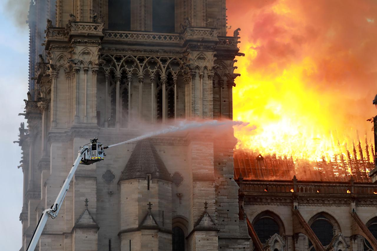 <p>A firefighter is seen fighting the flames at Notre Dame Cathedral April 15, 2019 in Paris, France. (Photo by Pierre Suu/Getty Images) </p>