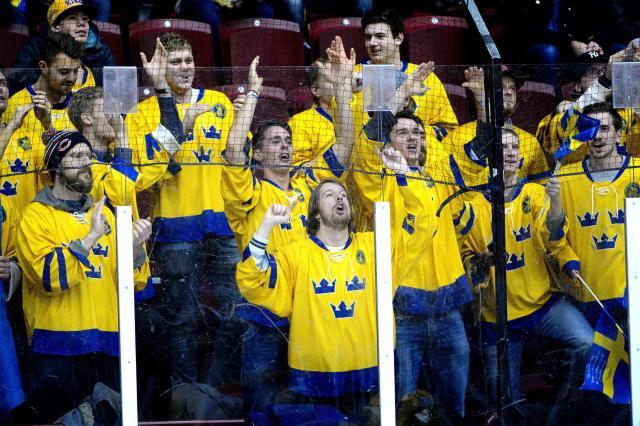 Swedish fans cheer their team on as they warm up before the IIHF World Junior Championship Group B preliminary round ice hockey match between Sweden and Finland at Malmo Arena in Malmo, December 28, 2013. REUTERS/Ludvig Thunman/TT News Agency (SWEDEN - Tags: SPORT ICE HOCKEY) ATTENTION EDITORS - THIS IMAGE HAS BEEN SUPPLIED BY A THIRD PARTY. IT IS DISTRIBUTED, EXACTLY AS RECEIVED BY REUTERS, AS A SERVICE TO CLIENTS. SWEDEN OUT. NO COMMERCIAL OR EDITORIAL SALES IN SWEDEN. NO COMMERCIAL SALES