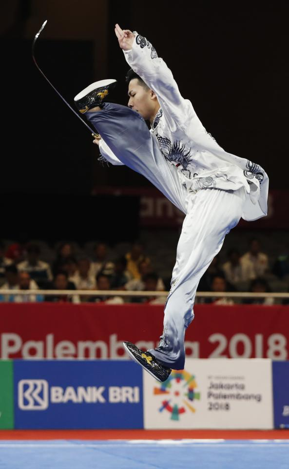 Wushu - 2018 Asian Games - Men's Taijijian - JIExpo Kemayoran Hall B - Jakarta, Indonesia - August 22, 2018. Tak Yan Samuei Hui of Hong Kong competes. REUTERS/Issei Kato
