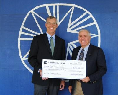 """Edward """"Ned"""" Handy III, Chairman & CEO of The Washington Trust Company and John Wolf, Executive Director of the San Miguel School in Providence, RI celebrate the $200,000 commitment to the school's STAR Campaign."""