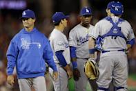 Los Angeles Dodgers manager Don Mattingly, left, leaves the mound after talking with his team during the seventh inning of a baseball game against the Washington Nationals at Nationals Park in Washington on Thursday, Sept. 20, 2012. The Nationals won 4-1. (AP Photo/Jacquelyn Martin)