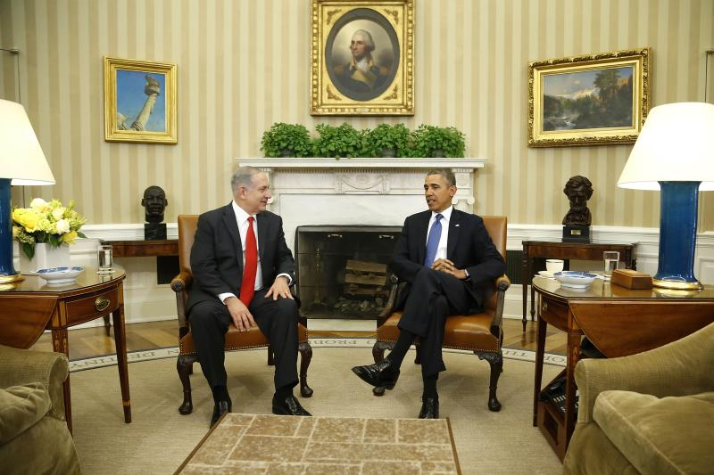 Netanyahu and Obama sit down to a meeting in the Oval Office of the White House in Washington