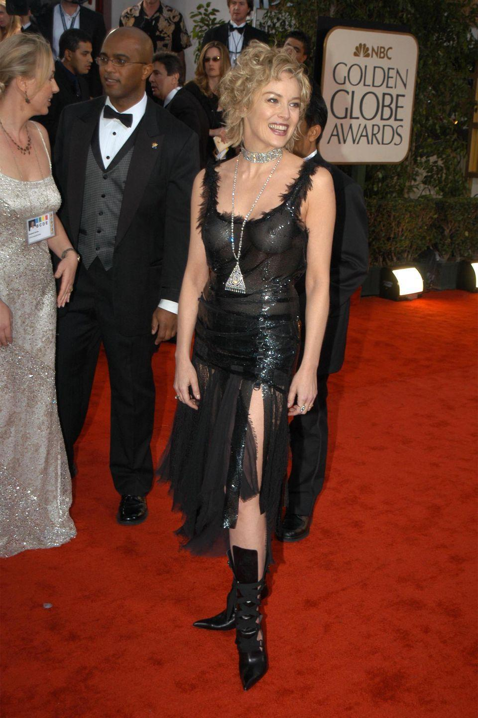 <p>In 2003, the actress looked a little bewitched in this black frock and pointed boots. </p>