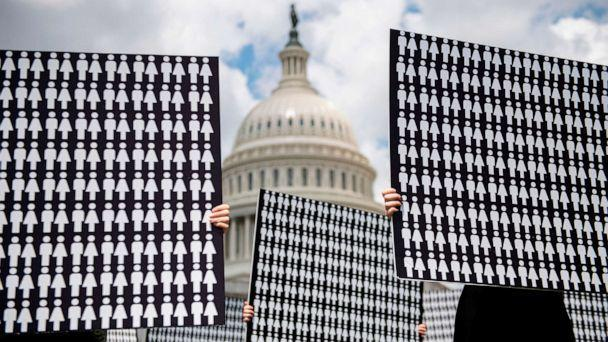 PHOTO: Demonstrators hold up placards representing the number of the people who have died due to gun violence on Capitol Hill in Washington, D.C. on June 20, 2019, during an event with gun violence prevention advocates. (Jim Watson/AFP via Getty Images)