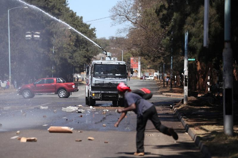 Zimbabwe's President Robert Mugabe accused foreign powers of having a hand in the unrest which saw opposition supporters clash with police in Harare (AFP Photo/Wilfred Kajese)