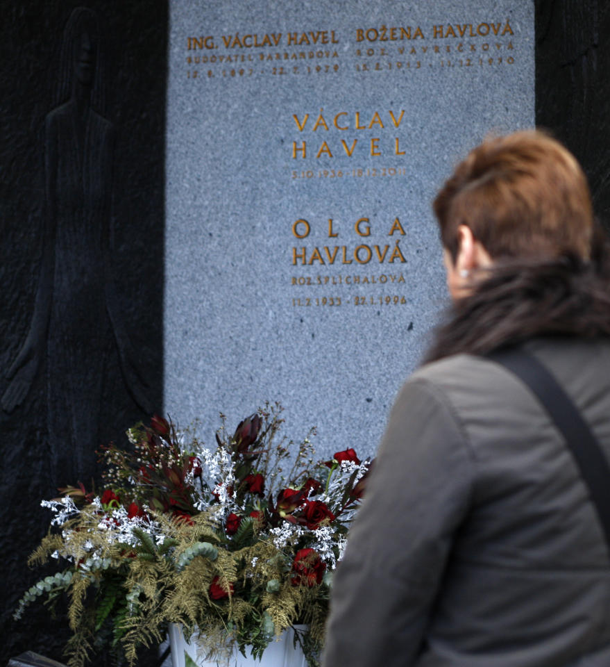 A woman pays a tribute at a family tomb of former Czech President Vaclav Havel after the urn with Havel's ashes was burried at the Vinohrady Cemetery in Prague, Czech Republic, Wednesday, Jan. 4, 2012. Vaclav Havel died Dec. 18, 2011 at age 75. (AP Photo/Petr David Josek)