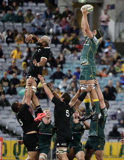 Australia's Rob Simmons, right, wins the lineout ball during the Bledisloe rugby test between the All Blacks and the Wallabies at Stadium Australia, Sydney, Australia, Saturday, Oct. 31, 2020. (AP Photo/Rick Rycroft)