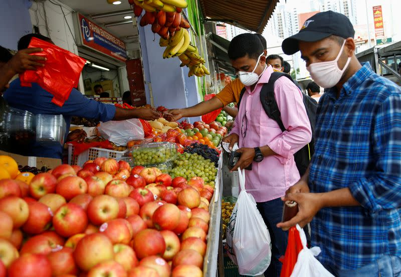 Migrant workers from Bangladesh shop for groceries on their day off in Singapore