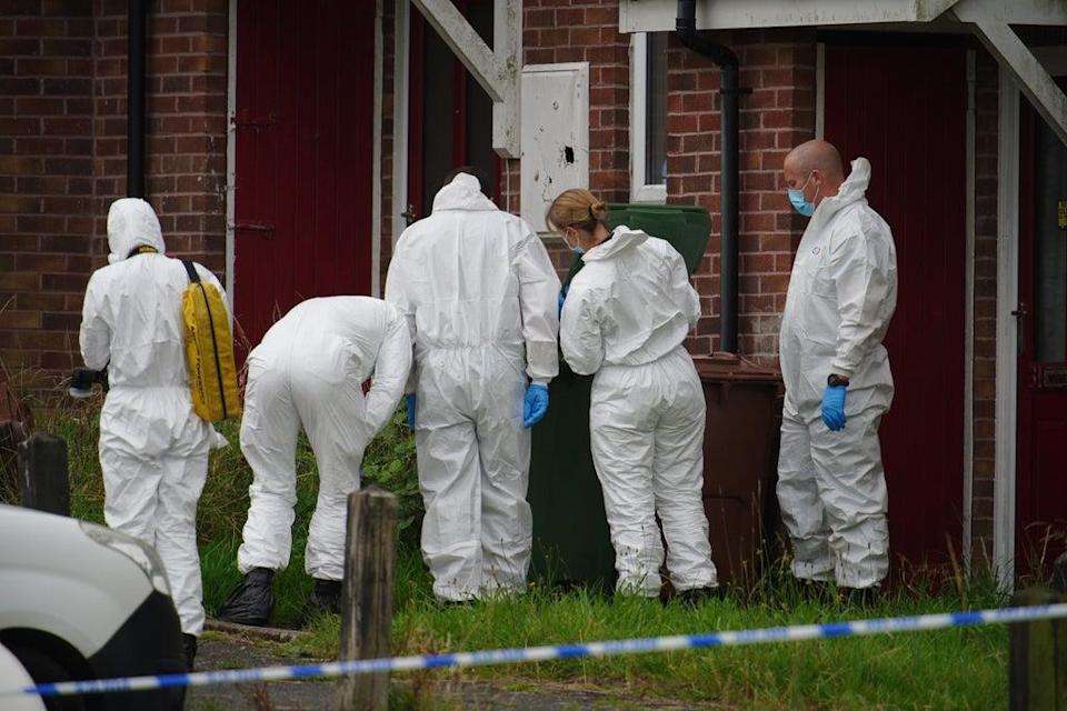Forensic officers at the scene of the shootings in Plymouth (PA) (PA Wire)