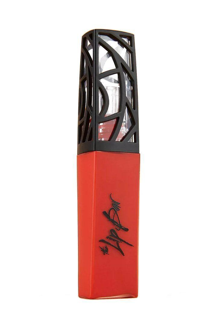 """<p><strong>The Lip Bar</strong></p><p>target.com</p><p><strong>$12.99</strong></p><p><a href=""""https://www.target.com/p/the-lip-bar-matte-liquid-lipstick-boy-trouble-24oz/-/A-52860826"""" rel=""""nofollow noopener"""" target=""""_blank"""" data-ylk=""""slk:SHOP IT"""" class=""""link rapid-noclick-resp"""">SHOP IT</a></p><p><strong>THE DETAILS: </strong></p><p>Before clean beauty was everywhere, those in the know turned to the Lip Bar. The brand was created in 2012 by Melissa Butler who wasn't afraid to ask the hard questions, as noted on her website: """"Why were most cosmetics filled with unnecessary chemicals? Why did lipsticks only come in a limited range of colors? And more importantly, why was the depiction of beauty so damn linear?"""" The Lip Bar has since become one of the most popular clean beauty brands to date, offering amazing products with color pay-off that keeps all complexions in mind. This lipstick, for instance, is a complete game-changer and suits all skin tones—here's <a href=""""https://www.thelipbar.com/collections/bright/products/boy-trouble"""" rel=""""nofollow noopener"""" target=""""_blank"""" data-ylk=""""slk:proof"""" class=""""link rapid-noclick-resp"""">proof</a>. </p><p><strong>WHY I'M OBSESSED: </strong></p><p>At first glance, this shade reminded me of beloved Lady Danger from MAC. However, after a closer look the unique blend of bright red and orange tones put this lipstick in a league of its own. It reads neon and the fiery shade is not for the faint of heart, which I'm completely cool with—I love a loud lip. That said, the texture is outright matte, so be sure to exfoliate your lips beforehand with a <a href=""""https://www.marieclaire.com/beauty/makeup/g32032052/best-new-lip-products-april-7-2020/"""" rel=""""nofollow noopener"""" target=""""_blank"""" data-ylk=""""slk:scrub"""" class=""""link rapid-noclick-resp"""">scrub </a>to avoid flakes. According to its name and <a href=""""https://www.thelipbar.com/collections/bright/products/boy-trouble"""" rel=""""nofollow noopener"""" target=""""_blank"""" data-ylk=""""slk:product description"""" class="""