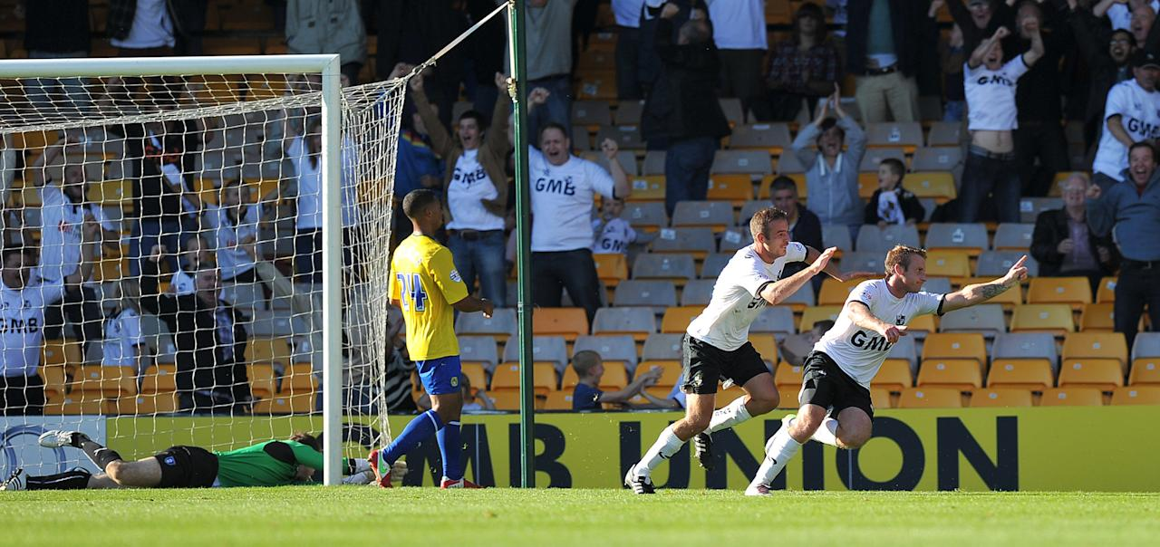 Port Vale's Chris Birchall (right) celebrates scoring the winning goal during the Sky Bet League One match at Vale Park, Stoke.