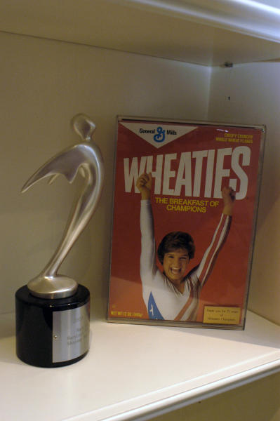 FILE- This photo taken Aug. 11, 2004, shows May Lou Retton's Wheaties box on display in her home in Houston. A gold medal used to be the golden ticket for lucrative endorsements, but in the age of social media, athletes are making a name for themselves well ahead of time. (E. Joe Deering/Houston Chronicle via AP, File)