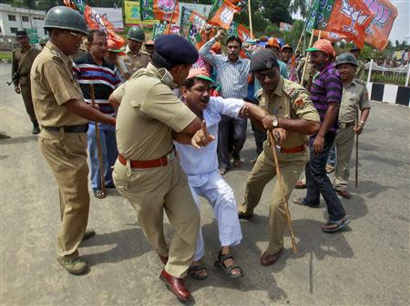 A supporter of India's main opposition Bharatiya Janata Party (BJP) shouts slogans as he is detained by police during a 12-hour strike in Agartala, capital of India's northeastern state of Tripura, May 12, 2014. REUTERS/Jayanta Dey