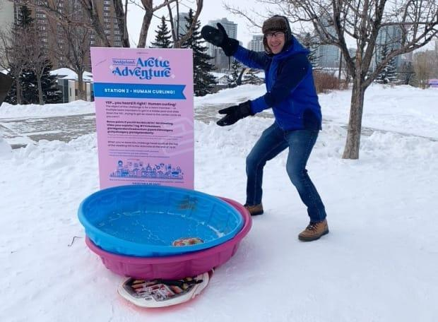 Bridgeland's Arctic Adventure Experience has participants try 'human curling,' which involves sliding down a hill in a kiddie pool into a painted bullseye.