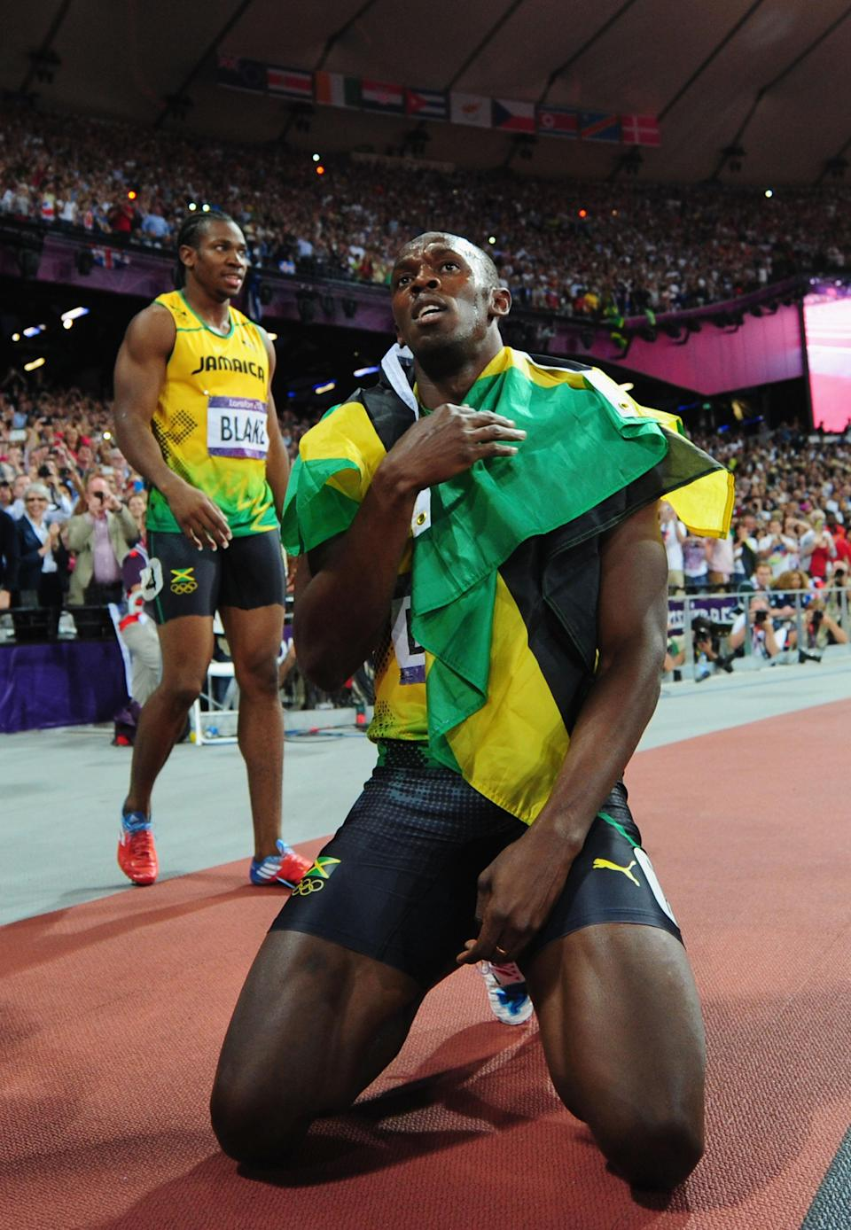 LONDON, ENGLAND - AUGUST 09: Gold medalist Usain Bolt of Jamaica celebrates next to silver medalist Yohan Blake of Jamaica after the Men's 200m Final on Day 13 of the London 2012 Olympic Games at Olympic Stadium on August 9, 2012 in London, England. (Photo by Stu Forster/Getty Images)