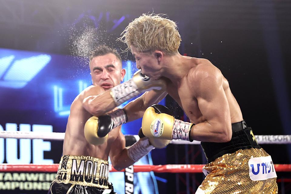 LAS VEGAS, NEVADA - OCTOBER 31: Naoya Inoue and Jason Moloney exchange punches during their bantamweight title bout at MGM Grand Conference Center on October 31, 2020 in Las Vegas, Nevada. (Photo by Mikey Williams/Top Rank Inc via Getty Images)