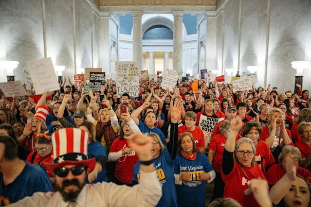 "<p>Striking school workers hold signs and chant inside the West Virginia Capitol in Charleston, W.Va., on Friday, March 2, 2018. A week ago, thousands of public school teachers in West Virginia went out on strike, a rare but familiar union-organized action to protest low wages and rising health-care costs. Tuesday night, state union leaders and the Governor Jim Justice reached a deal, and the teachers were expected to be back at work on Thursday, but they didn't go. Unsatisfied with the resolution, they stayed on the picket line, mounting one of the country's biggest unauthorized ""wildcat"" strikes in decades. (Photo: Scott Heins/Bloomberg via Getty Images) </p>"