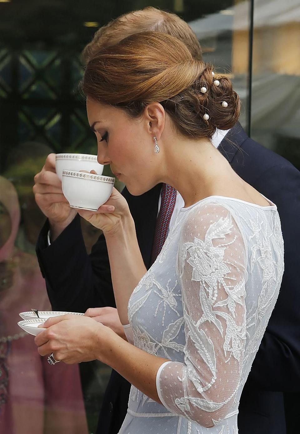 <p>The Duke and Duchess of Cambridge each take a sip of tea at the British High Commission in Kuala Lumpur, Malaysia. The royal couple were on a Diamond Jubilee Tour, stopping in Singapore, the Solomon Islands, and Tuvalu in addition to Malaysia.<br></p>