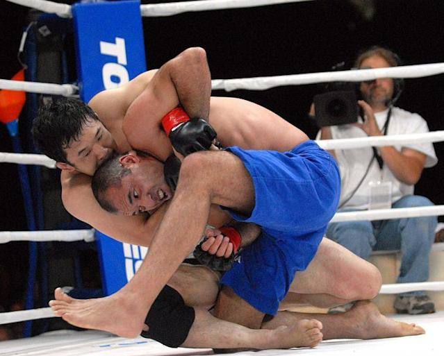 Kazushi Sakuraba (top), battling long-time rival Royce Gracie, was elected to the UFC Hall of Fame on Saturday. (Getty Images)