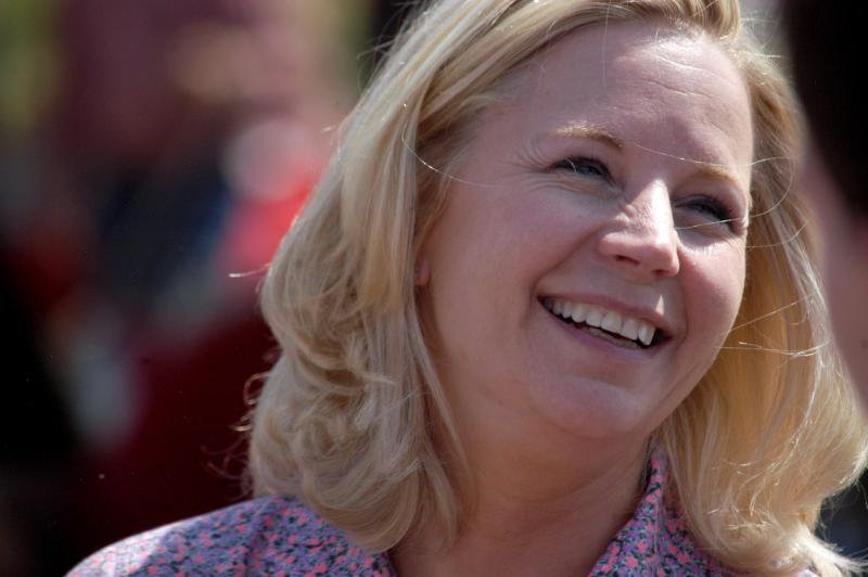 U.S. Senate candidate Liz Cheney speaks with voters during a Republican and Tea Party gathering in Emblem, Wyoming